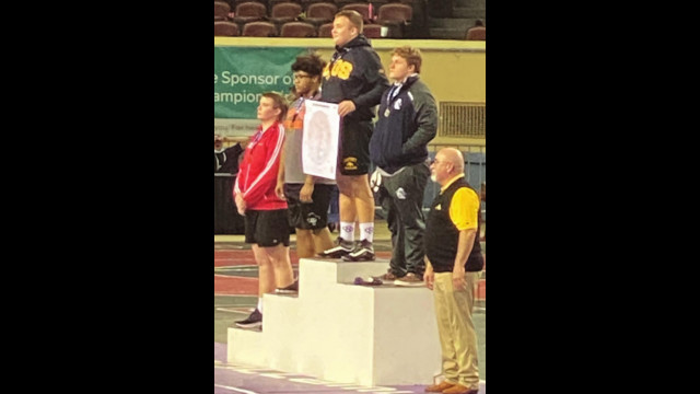 Miccael Brown placed third at state in 285 pound division, scores 13 points for Bucs